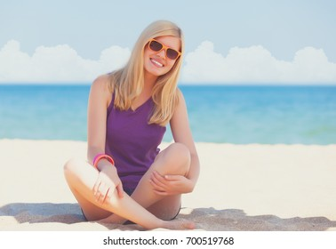 Beautiful blonde girl at the beach.