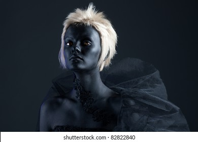 Beautiful blonde girl with black face