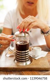 Beautiful blonde girl drinking cofee
