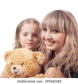 beautiful blonde girl embracing little child with her toy