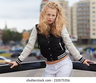 Beautiful blonde girl fashion with a girl in the city