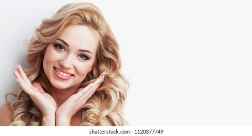 Beautiful blonde girl with healthy long curly hair