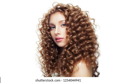 Beautiful blonde girl with healthy skin and perfect curly hair isolated on white background