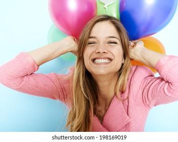Beautiful blonde girl holding balloons