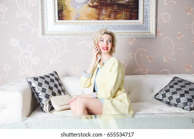 Beautiful blonde girl in a luxurious interior