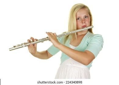 Beautiful blonde girl on a white background playing her flute