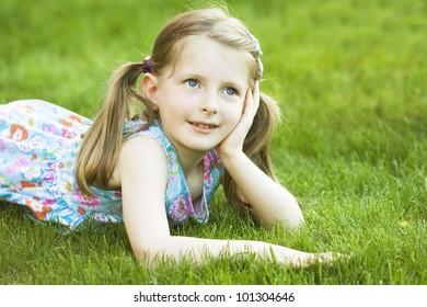 Beautiful blonde girl outside in a field.