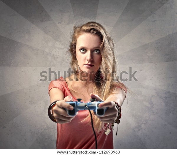 Beautiful blonde girl playing video games