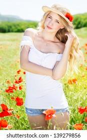 beautiful blonde girl in poppies field
