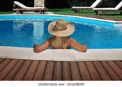 beautiful blonde girl relaxing in swimming pool