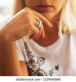 Beautiful blonde girl with rings on her finger