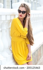 Beautiful blonde girl in sunglasses