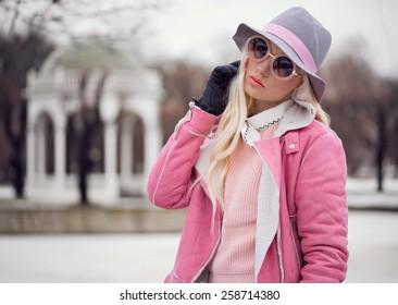Beautiful blonde girl in sunglasses outdoors