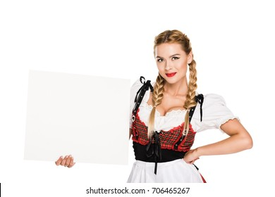 beautiful blonde girl in traditional german costume holding empty board, isolated on white