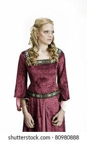 beautiful blonde girl in a vintage medieval dress