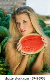 The beautiful blonde girl with water-melons