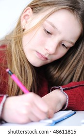 Beautiful blonde girl writing