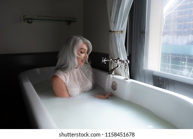 beautiful blonde gorgeous sexy woman in the milk bath