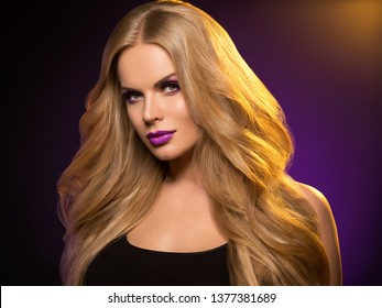 Beautiful blonde hair woman long healthy hairstyle purple color lipstick
