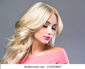 Beautiful blonde hairstyle woman with long blonde hair and beauty makeup female young model portrait