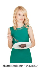 the beautiful blonde holds a plate with a piece of a chocolate pie