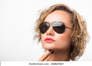 0f80d2e0cadf Beautiful blonde holds sunglasses. The girl on a white background with  sunglasses. Advertising sunglasses