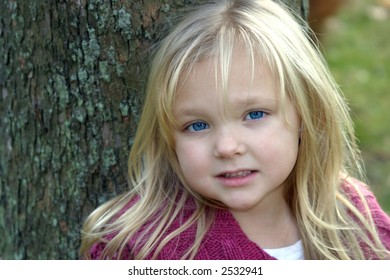 beautiful blonde little girl with big blue eyes