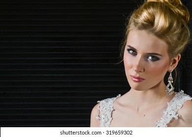 Beautiful Blonde With Long Hair Posing on Her Wedding Day