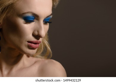 Beautiful blonde with luxury jewelry and closed eyes