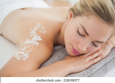 Beautiful blonde lying on massage table at the health spa