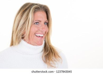 beautiful blonde middle aged woman looking side in blank copy space
