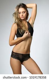 Beautiful blonde model in elegant black bodysuit