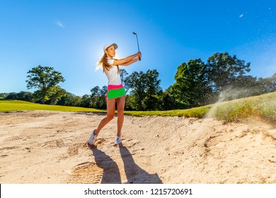 A beautiful blonde model enjoying a round of golf on a sunny day