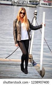 Beautiful blonde model on spring style wearing black jacket.