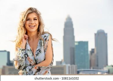 A beautiful blonde model posing outdoors in an urban environment