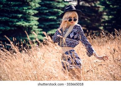 Beautiful blonde model in posing outdoors
