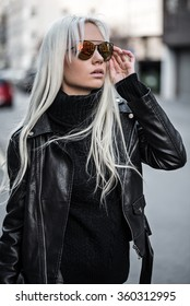 Beautiful blonde model posing outdoors