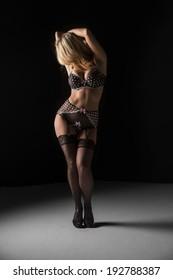 A beautiful blonde model posing in a studio environment