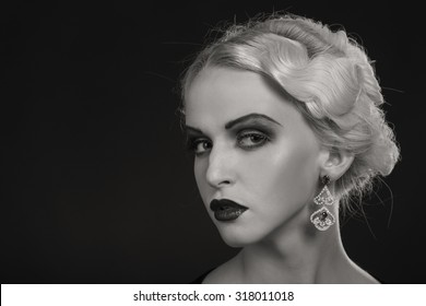 Beautiful blonde on a dark background. Portrait photo. A beautiful dress and accessories. Professional makeup. Beautiful model image lady 20s years.
