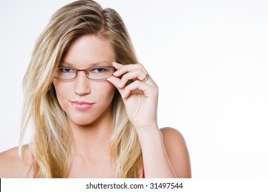 Beautiful blonde on a white back holding glasses