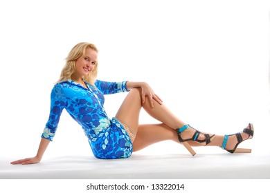 The beautiful blonde poses in studio