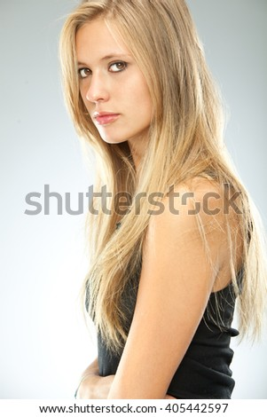 Beautiful Blonde Serious Girl Black Dressed Isolated On Grey
