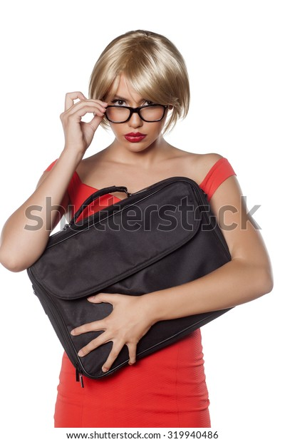 beautiful blonde with short hair and a laptop bag looking through the glasses