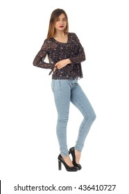 Beautiful blonde teenager in comfortable jeans isolated