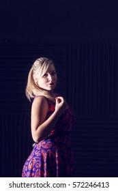 beautiful blonde in vivid dress
