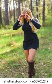 beautiful blonde walks in the woods , she's curvy