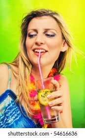 Beautiful blonde wearing lei holding a cocktail