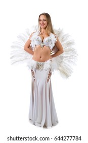 Beautiful blonde in white belly dancer costume with natural feathers and rhinestones . Woman with white fan . Beautiful professional make-up .Isolated on white background.