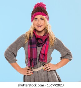 Beautiful blonde who is wearing a knitted red hat and a scarf
