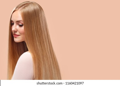 Beautiful Blonde Woman Beauty Model Girl with perfect makeup and long straight hair on light copyspace